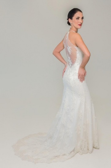 off white fitted sheath wedding gown with thin lace halterneck straps, low illusion back and cathedral train one-of-a-kind designer wedding gowns Cape Town Ilse Roux Bridal Shop